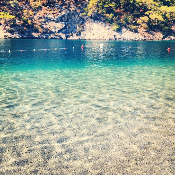 Ölüdeniz (official translation name Blue Lagoon) is a small beach resort in Fethiye district. With its secluded secluded bays and sandy beaches, Ölüdeniz is one of the most photographed beaches on the Mediterranean.