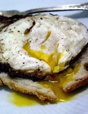 """JUST DO IT. AMAZING. How To:  Fry An Egg the Spanish Way--heat 1/4"""" oil in small, heavy skillet on med-high until almost smoking, slide in an egg and immed turn to med-low, and spoon hot oil over egg for a minute and a half (at most) and remove."""