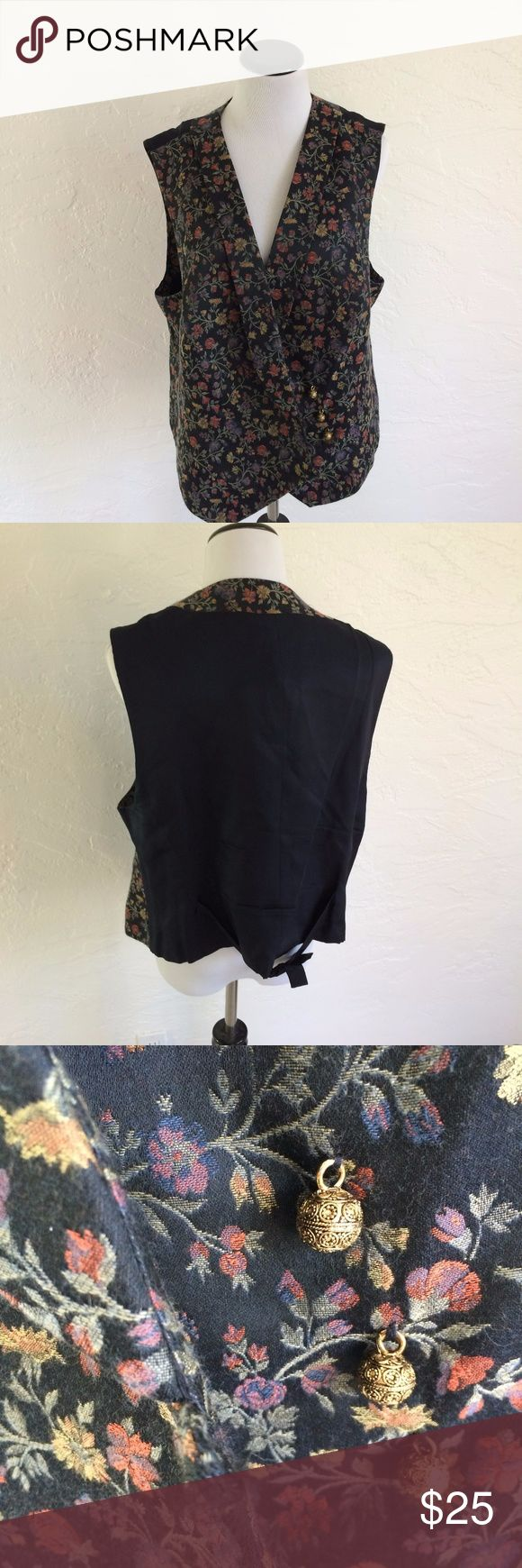 """ELLEN TRACY FLORAL VEST SIZE 18 BLACK AND FLORAL VEST, SIZE 18, COTTON AND POLYESTER, THREE GOLD COLORED CIRCLE METAL BUTTONS ON SIDE FOR CLOSURES, FABRIC TIE IN BACK.   MEASURED FLAT BUST 21"""" WAIST  23"""" LENGTH  28"""" Ellen Tracy Jackets & Coats Vests"""