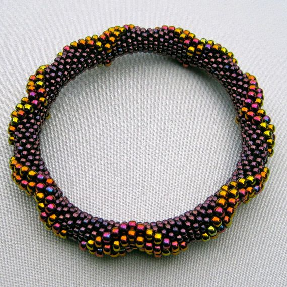 Add visual interest by varying the size of the beads in the rope.  Pattern for sale at the link.