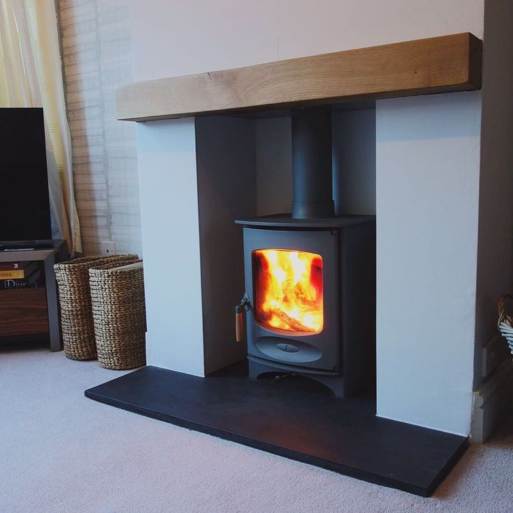 The C-Four by @charnwoodstoves looking fantastic in this simple setting. #newstoveinstall #charnwoodstoves #woodburning #woodburningstove #woodburner #hygge