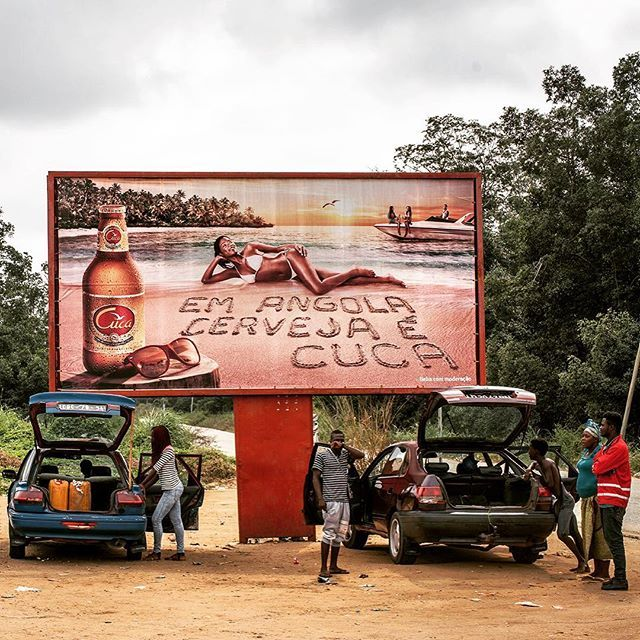 A billboard advertises #Cuca, Angola's most popular #beer, from a carpark in #Cabinda province. A sharp decline in international #oil prices has hit the #economy hard in #Angola, one of the world's most unequal countries. Photo by @nicholesobecki