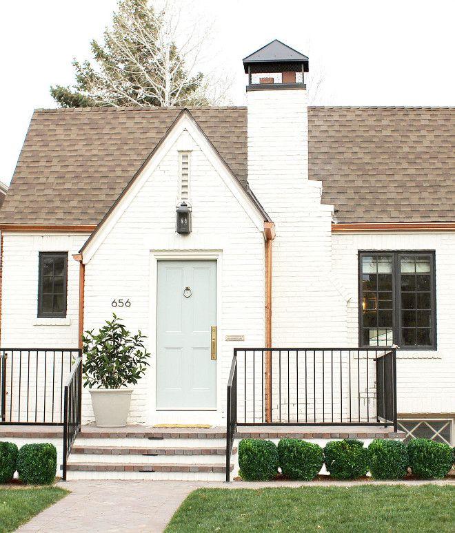 Exterior brick paint color is Benjamin Moore China White. Grey Door paint color is Benjamin Moore Greyhound.