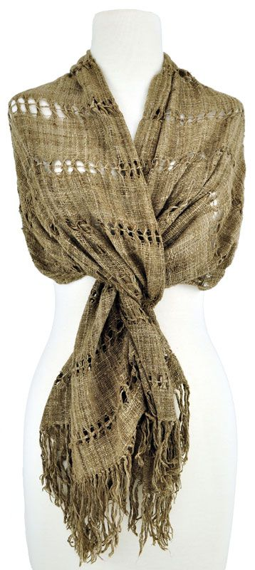 from Cloth Roads: This light-brown handspun, handwoven silk scarf from Madagascar creates a soft wrap with an excellent drape. Horizontal bands of weft-leno lace alternating with plain weave create a lacy feel. Each lace band is about 1/2″ wide; the plain weave bands are about 2 1/2″ wide. The wrap is finished with simple tied fringe.