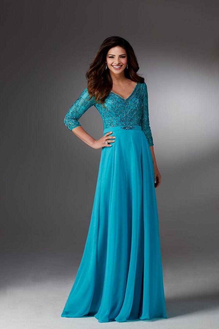 Długa, wieczorowa suknia Mori Lee, z rękawem 3/4. Efektowny gorset, zdobiony koralikami. Pasek, zaznaczający talię. Spódnica w kształcie litery A …