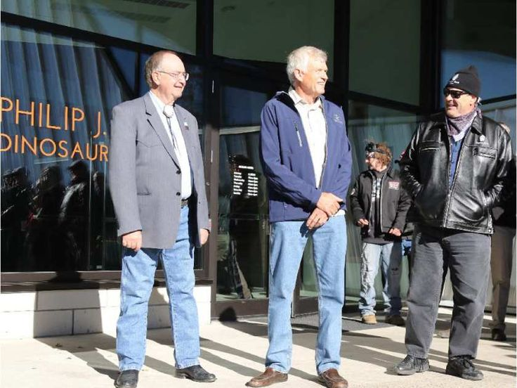 Ross Sutherland, left, chairman of the River of Death and Discovery Dinosaur Museum Society, Philip Currie, a University of Alberta paleontologist, Dan Aykroyd attend the unveiling of the cornerstone at the Philip J. Currie Dinosaur Museum on Saturday Sept. 26, 2015 in Wembley.