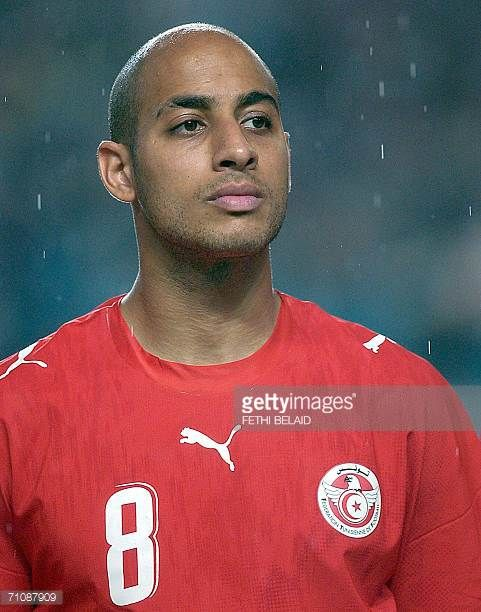 Tunisian midfield Mehdi Nafti stands during a friendly football match against Belarus at Rades Stadium in Tunis 30 May 2006 ahead of the 2006 World...