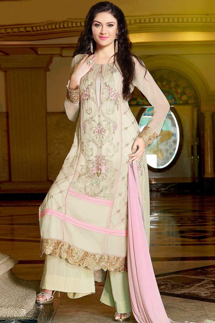 Cream Georgette Trouser Suit with Chiffon Dupatta Price:-£49.00 Cream Georgette, semi stictch trouser suit. Allover embroidered with embroidered, resham and zari work.Boat neck , Below knee length , full sleeves kameez.Cream santoon trouser .Light pink, chiffon dupatta with lace border with work.It is perfect for casual wear, festival wear and party wear wear. http://www.andaazfashion.co.uk/cream-georgette-trouser-suits-dmv13476.html