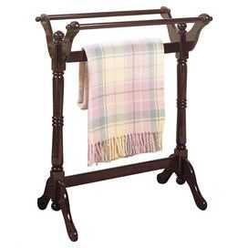 "Quilt rack with 3 draping bars and a turned post design.   Product: Quilt rackConstruction Material: WoodColor: CherryFeatures: Turned postDimensions: 32.5"" H x 25"" W x 16.5"" D"