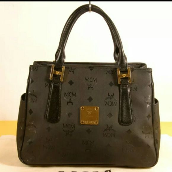 Aunthenic MCM handbag-vintage Has serial number Small..has side.pocket Great condition Minor signs of wear Comes with dust bag MCM Bags Satchels