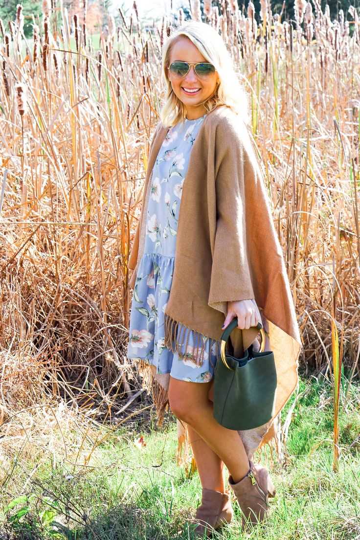 Camel tassel poncho and blue floral dress for Thanksgiving outfit >> www.amybelievesinpink.com