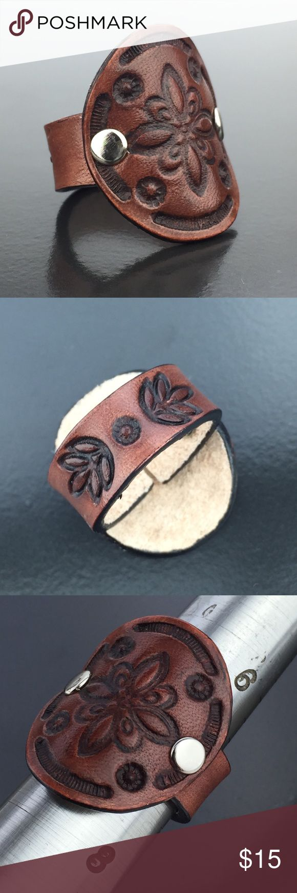 Leather Ring Sienna Maru Hand Tooled Nickel Sz 7 Refined rustic leather ring crafted from flexible genuine cowhide leather. Sienna brown with antiqued impressions, contrasting black edges, nickel hardware. Size 7. Cut, tooled, and finished by hand. No two exactly alike. Care for leather jewelry and accessories as you would leather shoes and bags - keep dry, buff with a soft cloth, condition as desired as time, weather, and wear distresses the leather. Handmade USA, GemFOX Boutique. GemFOX…