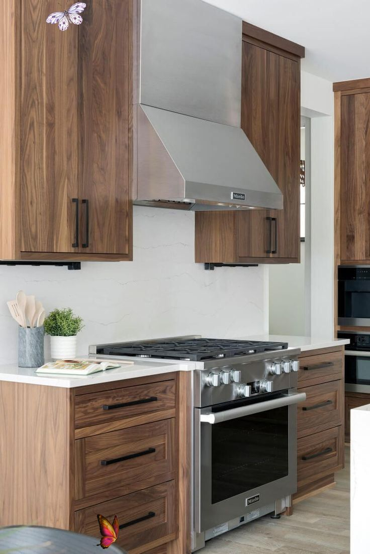 Top Of The Line Kitchen With Dark Wood Cabinets White Counter Top And Stainless Stee In 2020 Modern Kitchen Design Transitional Kitchen Design Kitchen Cabinet Design