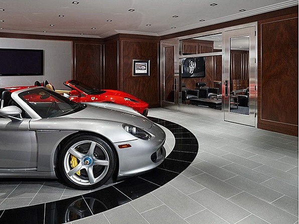 Lounge featuring a custom auto showroom with car turntable for Garage auto 93