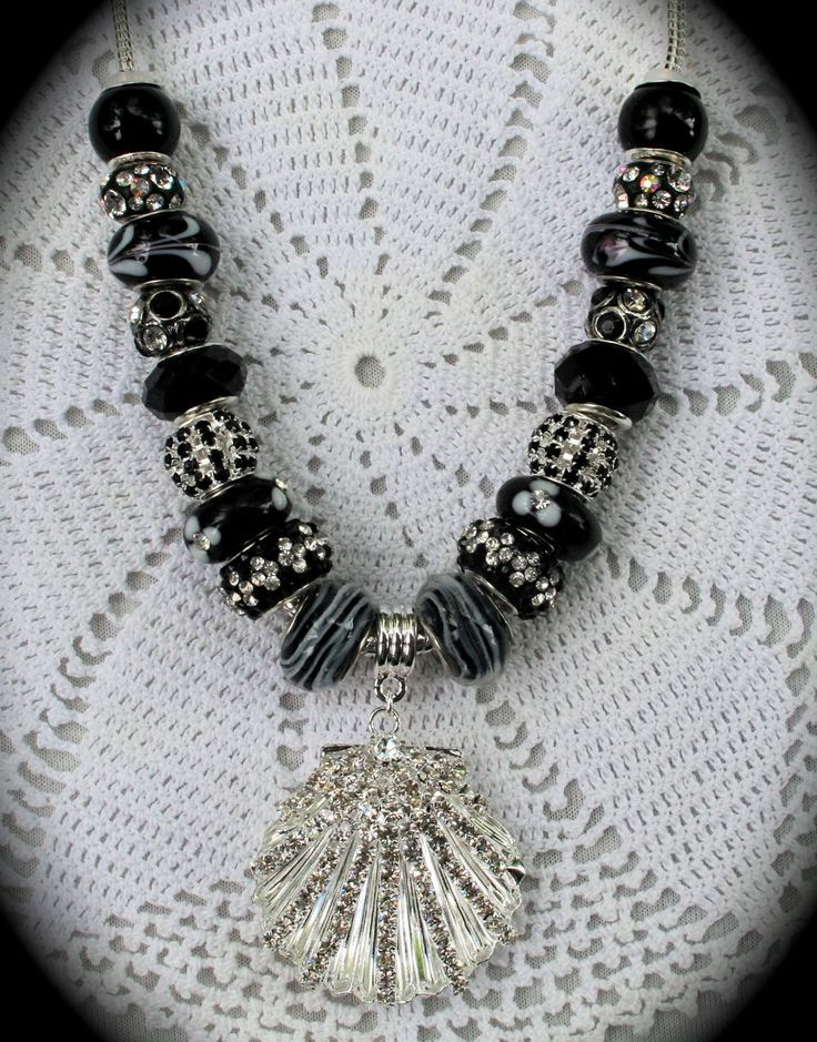Beautiful black and silver shell necklace! Only $25! Contact me at mlprociuk@gmail.com
