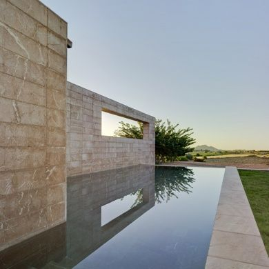 Spa + Hotel La Romana: Project: Spa + Hotel La Romana Architect: Isaac Peral Codina Project Location: Alicante, Spain Project Date: 2012 This austere hotel and spa uses local natural materials such as Marble Rojo Alicante, which is a local stone, to blend in with the surroundings. Inside, natural sunlight creates interesting and striking patterns through strategically punctured exterior wall with sun shading systems of linear pattern, making this place such a serene experience.