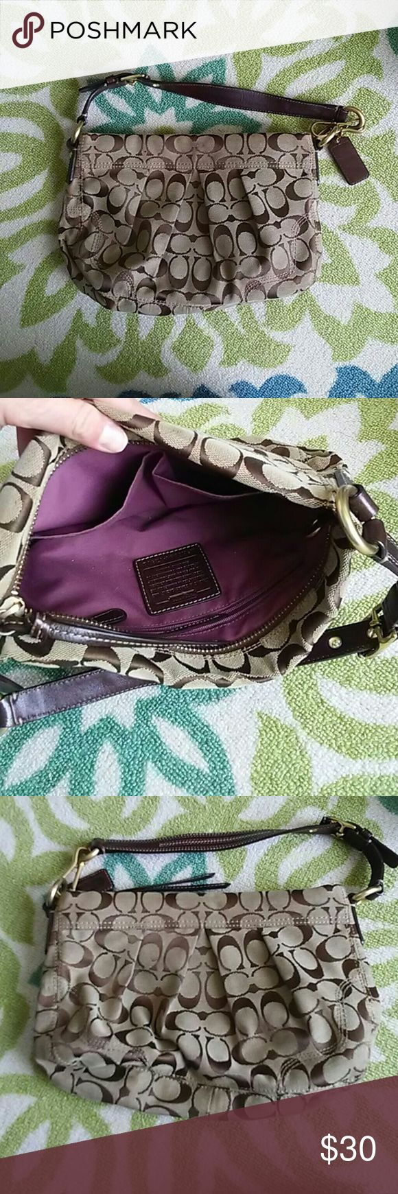 Coach Signature C Brown Purse Purple Lining Beautiful Signature C brown Coach purse with elegant pleating of the fabric. Has a beautiful maroon lining with two drop tech pockets and one zippered pocket. Some wear on inside, small spot on back, and bottom of purse. Please see pictures.  FAST NEXT DAY SHIPPING! Smoke/Pet free Home! 3+ Bundle=Discount Coach Bags