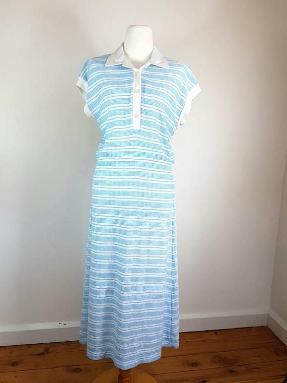 DESCRIPTION ↣ Vintage 90s summer dress ↣ Blue and White stripes ↣ 3 buttons at the front ↣ Brand: no brand / top ↣ Thick and flexible material ↣ Condition: Excellent MEASUREMENTS (approx.): - Size 36 / AU8 / S - Lenght: 100 cm - Burst: 40cm x 2 MATERIAL: viscose / polyester / cotton