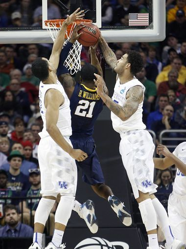 Kentucky Willie Cauley-Stein, right, and Trey Lyles blocking Williams' shot in Sweet 16 game. 3-26-15