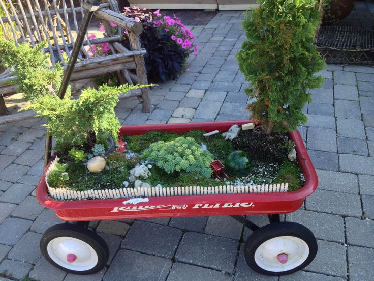 Fairy Garden Container Ideas fairy garden for sarah and emma like the moss on the cottage Cute Red Wagon Fairy Garden Container Wwwwolfsbloomsandberriescom