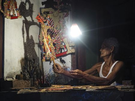 Merto, the shadow puppet maker Photo by Irawan Subingar — National Geographic…