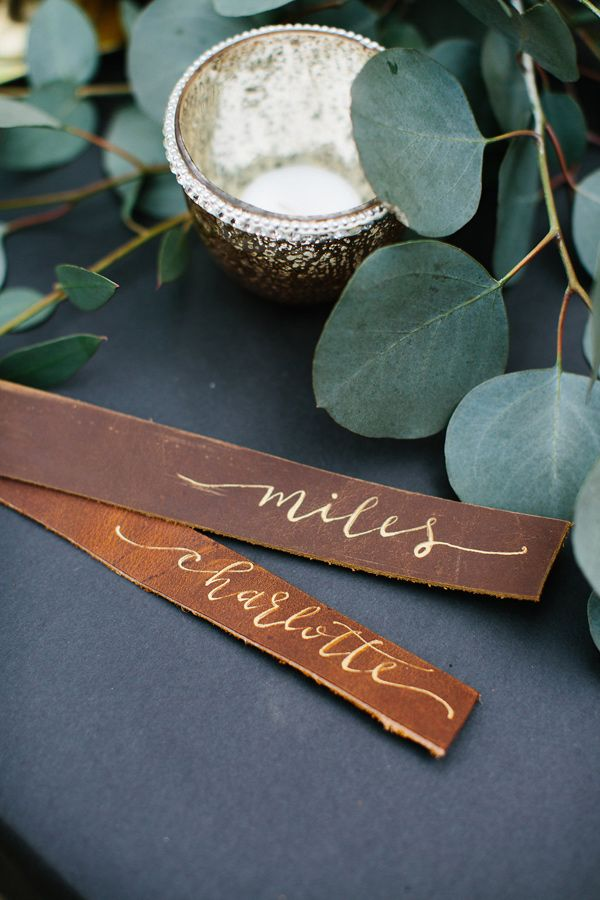 leather place cards - photo by Meg Cooper Photography http://ruffledblog.com/luxe-northwoods-wedding-inspiration