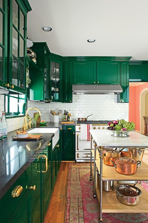 Tired of white kitchens, they drenched the space in deep, dark green in a glossy, laquered finish