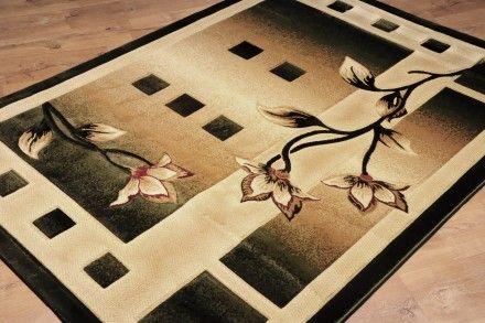 Dywan ręcznie wycinany Kalie zieleń. Dywan z motywem kwiatów wykonany w technologii Heat Set.