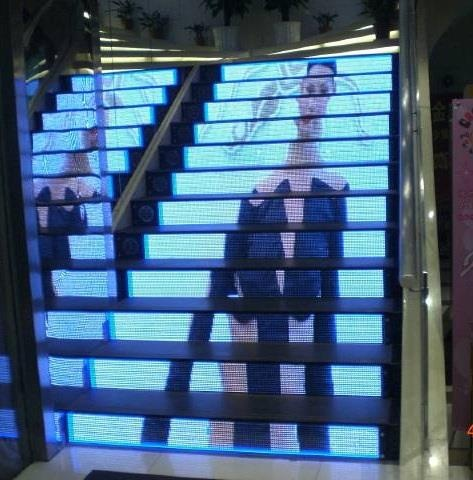 Watch your steps, literally.. hehe... this TVJUMBO on a staircase with sound is a riveting sidewalk television with sound 216-475-9800
