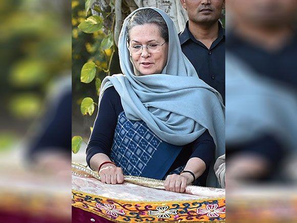 Sonia Gandhi  holding a 'chadar' before sending it for the shrine of Khwaja Moinuddin Chishti  in Ajmer