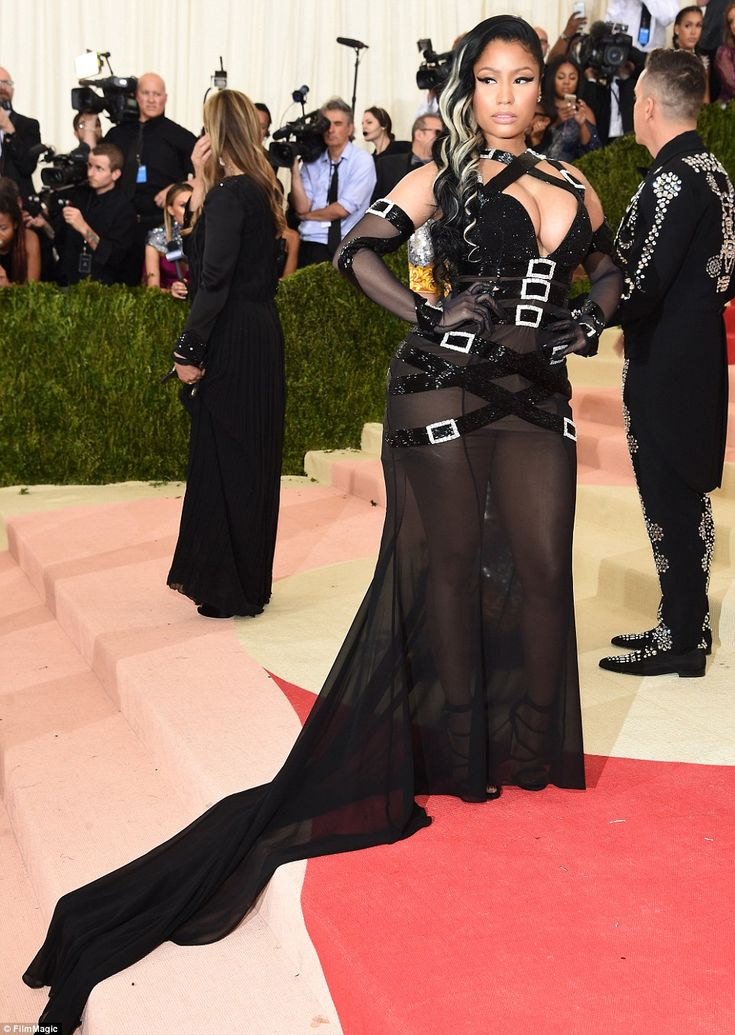 "Nicki Minaj cinched herself into a black Jeremy Scott for Moschino dress.| ""Manus x Machina: Fashion In An Age Of Technology"" Costume Institute Gala at Metropolitan Museum of Art on May 2, 2016 in New York City. 