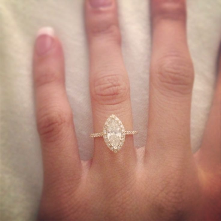 marquise diamond engagement ring with thin diamond halo and band set in 14k rose gold