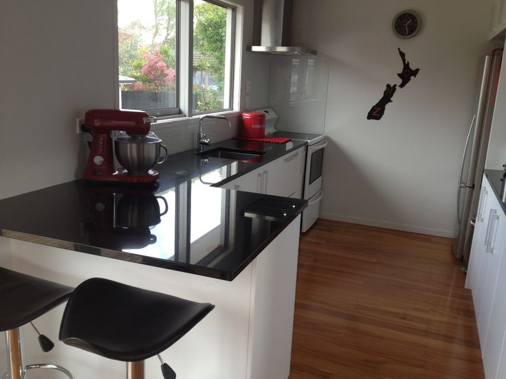 White doors with black benchtop - Kitchens 2 Go