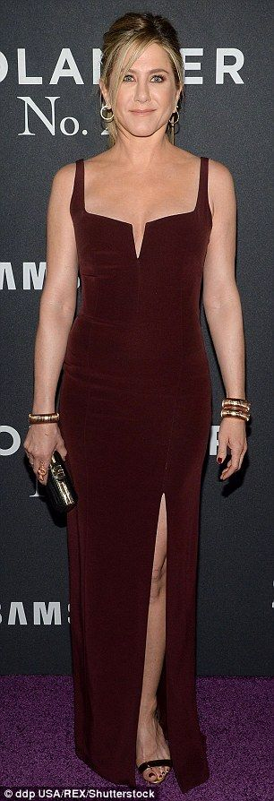 The blonde star completed her red carpet look with a pair of gold Giuseppe Zanotti heels and Judith Lieber jewellery and carried a Sidney Garber clutch bag.