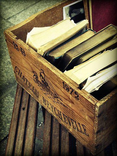 Old books in a wine crate