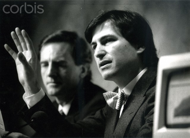 John Sculley (left) and Steve Jobs of Apple Computers speak at a press conference following the annual shareholders meeting on Jan. 23, 1985