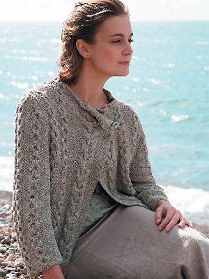 Woman wearing cable knit wrap jacket free knitting patterns
