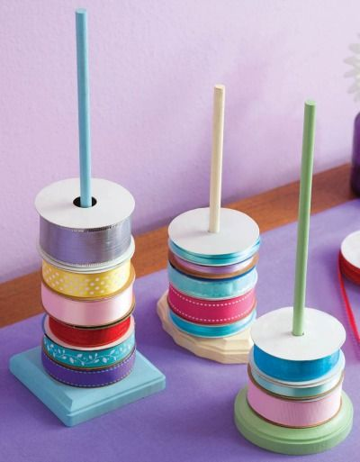 Give your ribbon stash an organized update with these cute DIY Ribbon Storage rods -- so easy to make! | craft room storage