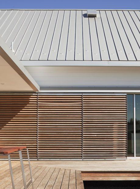 Metal roof & sliding wood doors - Hufft Projects