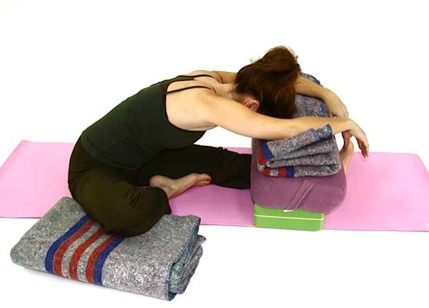 Supported Janu Sirsasana 1 x bolster. 2 x blocks (place under the ends of the bolster to give more height). 2 x blankets -- 1 for under the knee, and 1 to place on the bolster for extra height if needed.