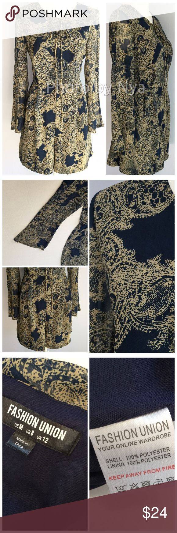 Romper ASOS Fashion Union Blue navy blue romper with detail pattern.  Front features lace up around chest area.  Long sleeves are wide at the end,  no flaws,  perfect condition. All measurements are in last photo. ASOS Dresses Long Sleeve