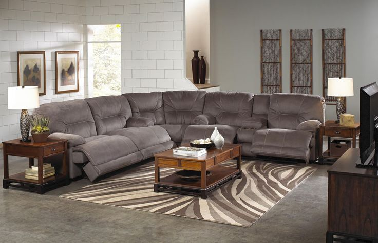 The Noble Group features a casual contemporary styling, luxurious Nubuck suede-like fabric, decorative luggage stitching, and lay flat reclining.