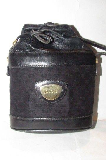 85e437b7ecc Gucci Early Cross Body Bucket Purses Black Small G Logo Print Logo Print  Canvas and Black Leather with Gold Hardware Satchel - Tradesy
