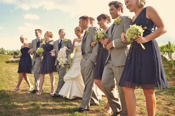 Gray groomsmen suits with navy bridesmaids dresses