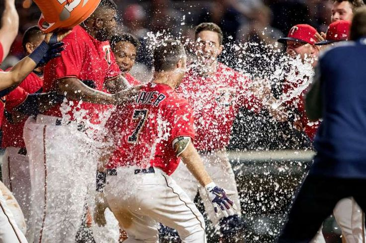 May 5, 2017; Minneapolis, MN, USA; Minnesota Twins gets water poured on him as he touches home plate after hitting a walk off home run in the ninth inning to defeat the Boston Red Sox at Target Field. Mandatory Credit: Jesse Johnson-USA TODAY Sports  (Photo: Jesse Johnson, Jesse Johnson)