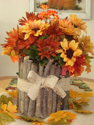 Using branches from your backyard, attach them to an empty coffee can with hot glue, then fill with flowers.
