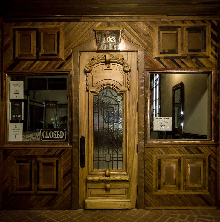 Gorgeous antique door and salvaged wood exterior from Southern Accents Architectural Antiques graces the entrance of Mefford Jewelers in downtown Florence, Alabama - www.sa1969.com