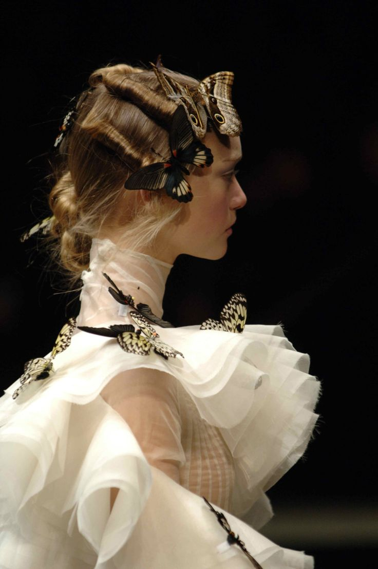 """A modern take on Miranda's costume, emphasizing her purity (white, airy fabric) and her appreciation of and connection to nature (butterflies). Fashion from Alexander McQueen Autumn/Winter 2006 Collection.   """"O, if a virgin, and your affection not gone forth, I'll make you the queen of Naples."""""""