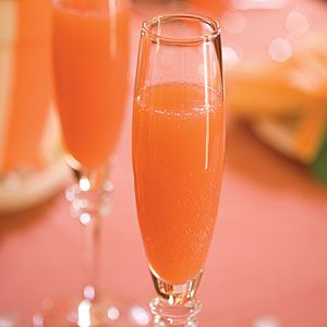 Blushing Mimosas for a holiday brunch—add pineapple juice and grenadine for a tasty twist!