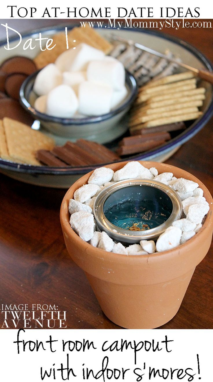 I am SO into this idea! indoor-smores-date-night-at-home-camp-out-in-front-room